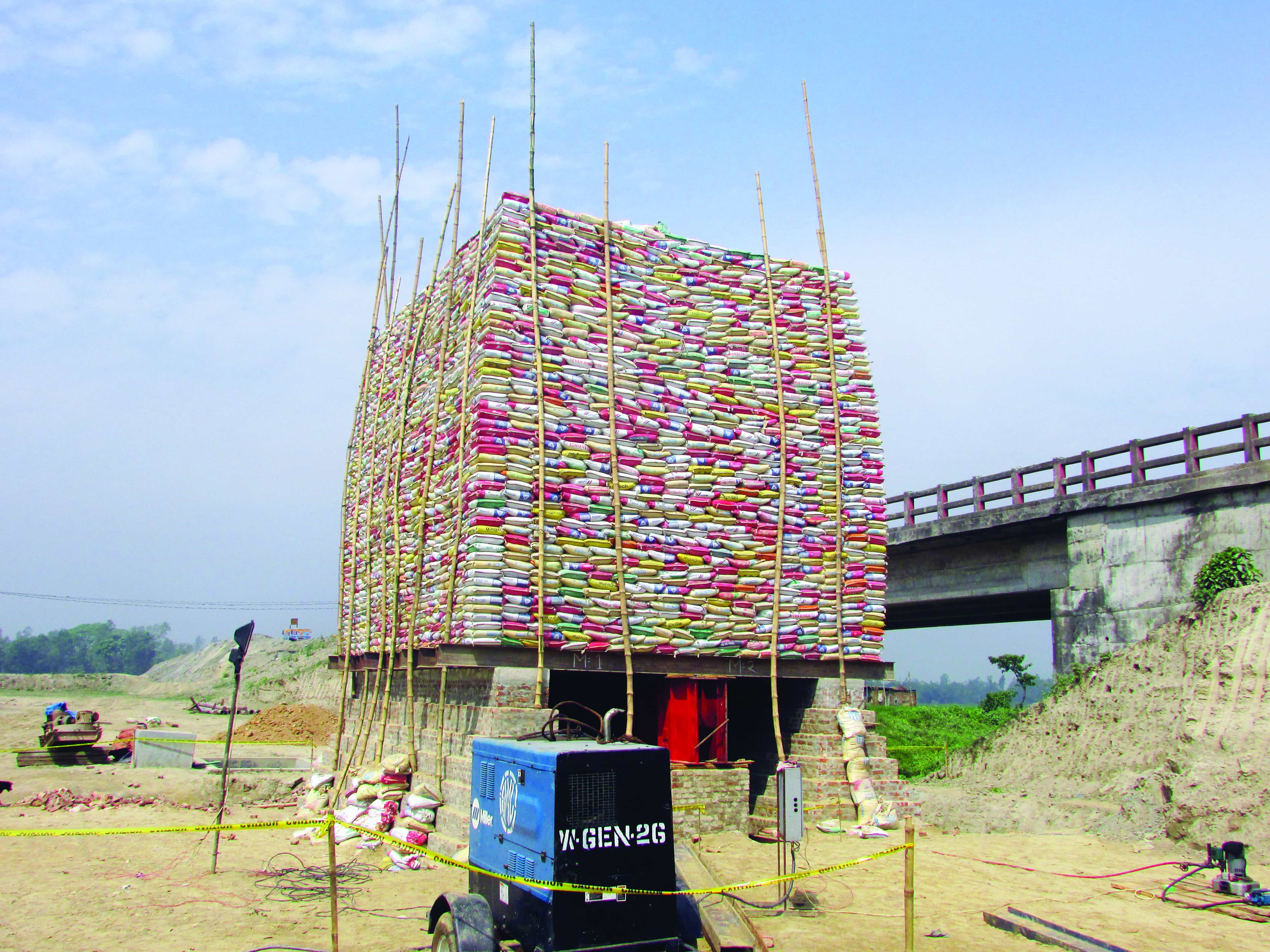 Pile load test by kentledge method for rail bridge on Titas river at Akhaura.